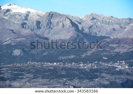 The mountain resort of Crans Montana in Southern Switzerland surrounded in by forests and mountains  - stock photo