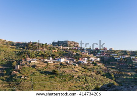 The mountain village Chipude situated In the highlands of La Gomera on the Canary archipelago. In the background the famous mesa La Fortaleza, one of the landmarks on the Island - stock photo