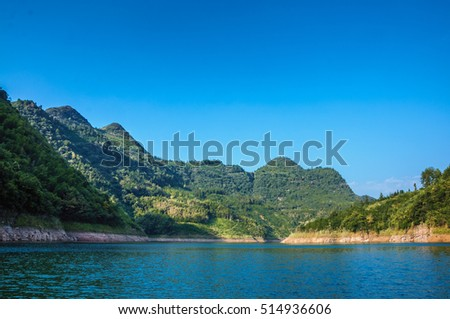 The mountains and reservoir scenery with blue sky