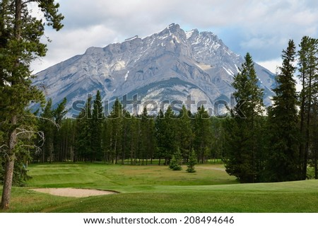 The mountains of Banff, Alberta, Canada.Banff National Park has many awesome sites.From mountain peaks to hiking, biking, boating, come to Banff and explore nature. - stock photo