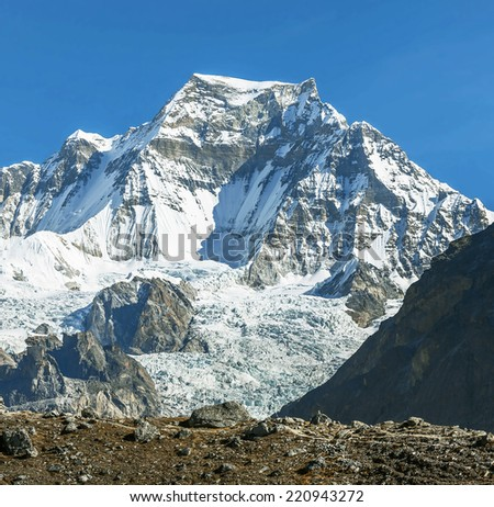 The mountains peak Gyachung Kang (7012 m) - Gokyo region, Nepal, Himalayas - stock photo