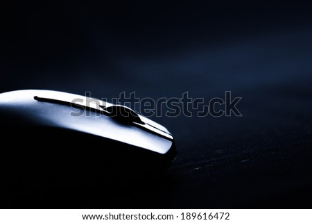 The mouse with a wheel on a black background - stock photo