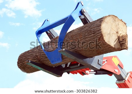 The movement of the log loader in the sky - stock photo