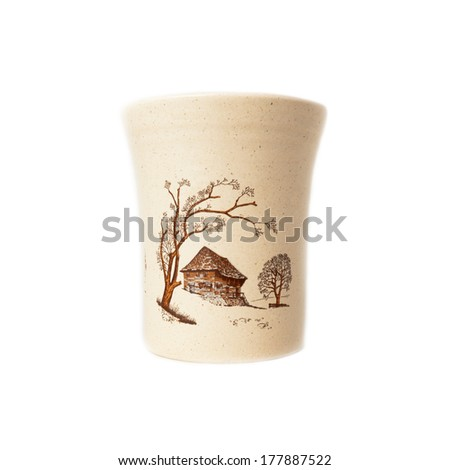 The  mug ceramics with scenery painted on it  isolated over white - stock photo