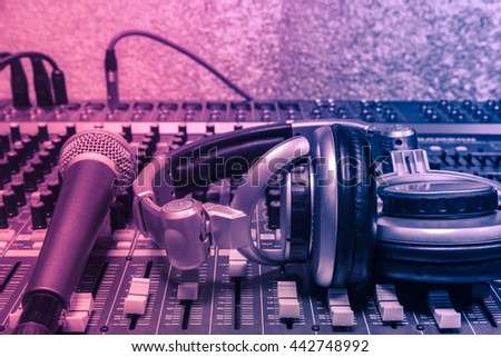 The music instruments or dj  equipment concept the headphones and microphone on sound mixer music background. - stock photo
