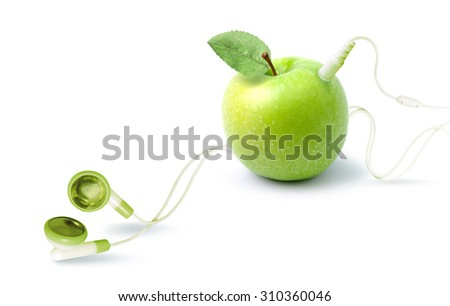 The music player in the shape of an apple with headphones. Fantasy on the theme of music and fruits. - stock photo