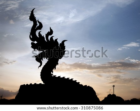 The naga silhouette on sunset background
