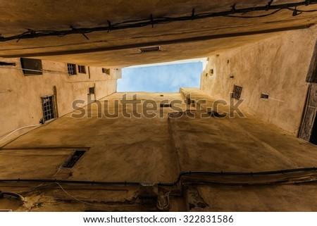 the narrow medina of fes morocco - stock photo
