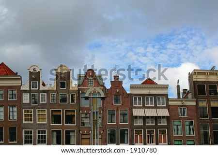 The narrow row houses of Amsterdam, the Netherlands. - stock photo