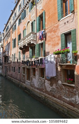 The narrow street - channel in Venice, Italy - stock photo