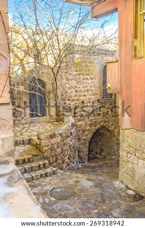 The narrow street going down to the shopping area of the old town of Mardin, Turkey.