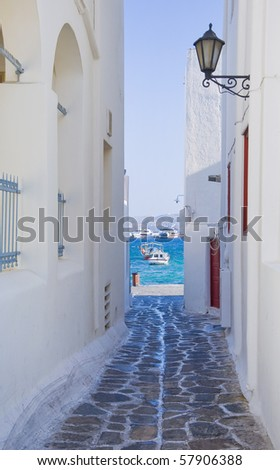 The narrow streets leading to the Greek island port of the sea - is typical of the Mediterranean... - stock photo