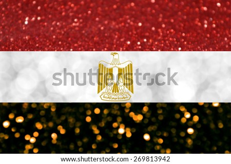 The National flag of Arab Republic of Egypt made of bright and abstract blurred backgrounds with shimmering glitter - stock photo