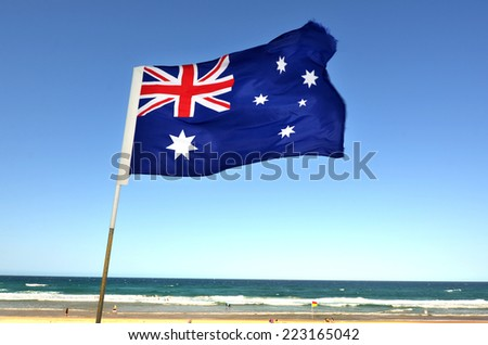 The National flag of Australia flay over the Gold Coast in Queensland, Australia. - stock photo