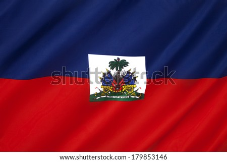 The national flag of Haiti. The coat of arms depicts a trophy of weapons ready to defend freedom and a royal palm for independence. The palm is topped by the Cap of Liberty.