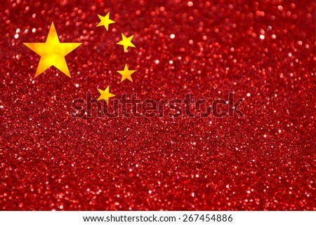 The National flag of People's Republic of China made of bright and abstract blurred backgrounds with shimmering glitter - stock photo
