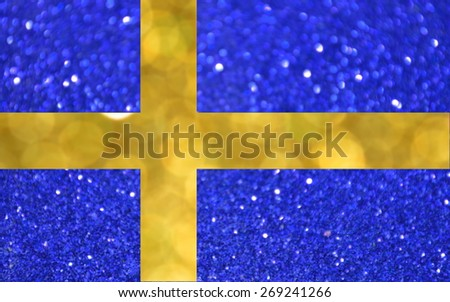 The National flag of Sweden made of bright and abstract blurred backgrounds with shimmering glitter - stock photo