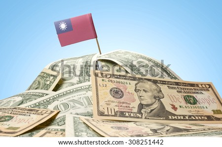 The national flag of Taiwan sticking in a pile of american dollars.(series) - stock photo