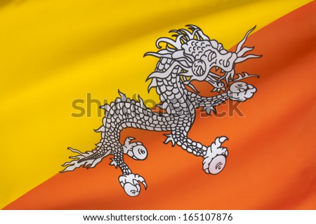 The national flag of The Kingdom of Bhutan - The flag is based upon the tradition of the Drukpa Lineage of Tibetan Buddhism and features Druk, the Thunder Dragon of Bhutanese mythology.
