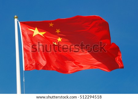 The national flag of the People's Republic of China on blue sky.