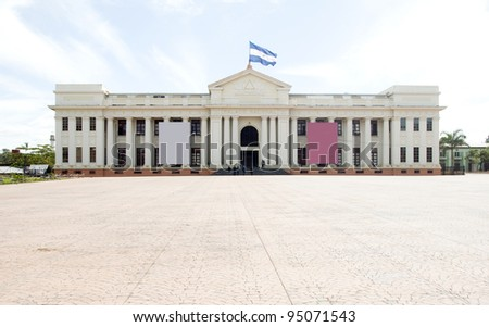 the National Palace and Culture Museum Plaza of Revolution in Managua Nicaragua Central America with national flag flying - stock photo