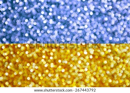 The national yellow and blue flag of Ukraine made of bright and abstract blurred backgrounds with shimmering glitter - stock photo