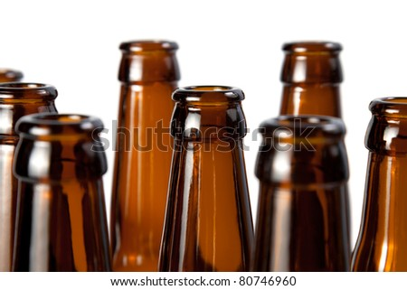 The necks of beer bottles brown glass isolated on white - stock photo
