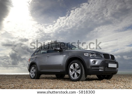 The new BMW X5 lit under a moody sky - stock photo