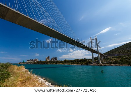 The new cable bridge of Chalkida, Greece that connects the island of Evia with mainland Greece against a blue sky - stock photo