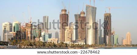 The New District of Doha under construction during the Arabian Gulf building boom, December 30, 2008. Panorama from merged images. - stock photo