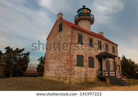 The New Jersey East Point lighthouse protecting traffic on the Delaware bay - stock photo