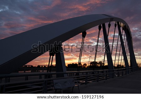 The new Main Street Bridge in Columbus, Ohio at sunset - stock photo