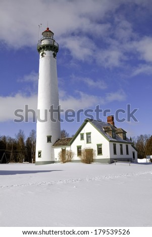 The New Presque Isle stands tall on a cold winter's day. The Lighthouse is located just outside of Alpena, Michigan, USA. - stock photo