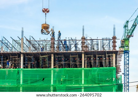 The new under construction building and construction tower canes in Bangkok, Thailand - stock photo