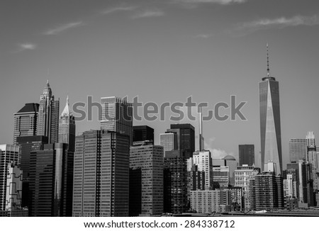The New York City Down Skyline from Brooklyn Bridge in black and white