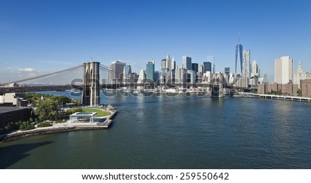 The New York City Downtown w Brooklyn Bridge and Freedom tower - stock photo