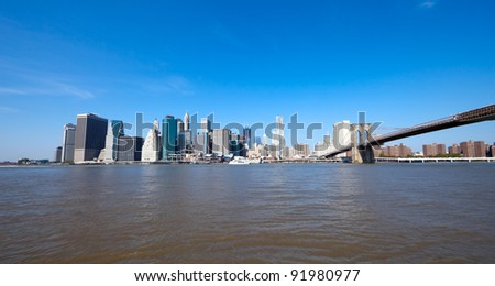 The New York City skyline at afternoon w the Freedom tower and Brooklyn bridge