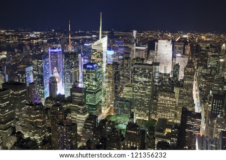 The New York City Uptown panorama with Times Square in the night - stock photo