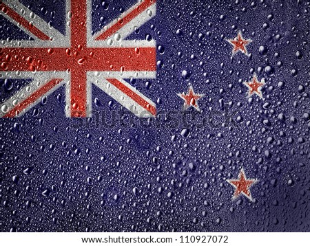 The New Zealand flag painted on metal surface covered with rain drops - stock photo