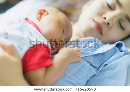 The newborn baby sleeping on mothers chest co sleeping mother and baby child