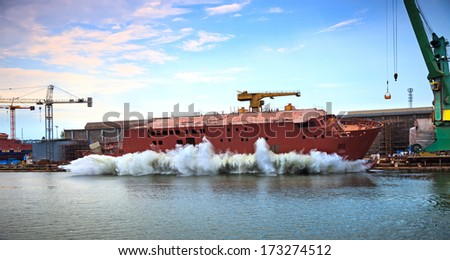 The newly built vessel during launching of the shipyards. - stock photo