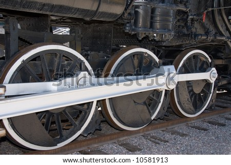 The newly refurbished wheels of a 1911 locomotive shows the intricate detail of craftsmanship.