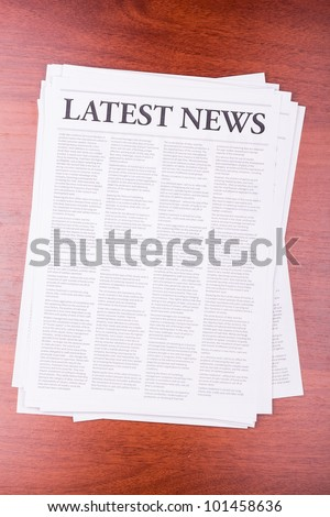 The newspaper LATEST NEWS on table - stock photo