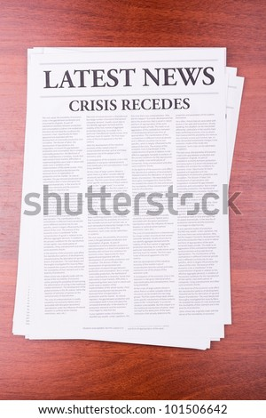 The newspaper LATEST NEWS with the headline CRISIS RECEDES - stock photo