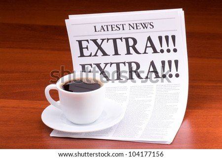 The newspaper LATEST NEWS with the headline EXTRA! EXTRA! on table - stock photo