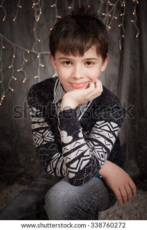 the nice boy on a New Year's background   - stock photo