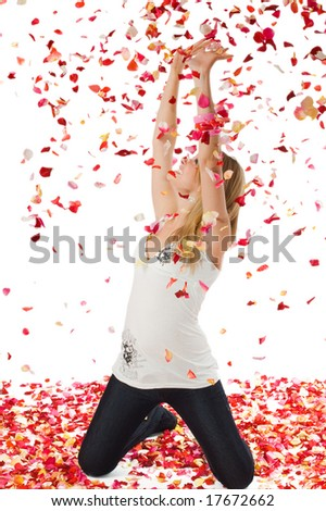 The nice girl covered with petals of roses, isolated on white - stock photo