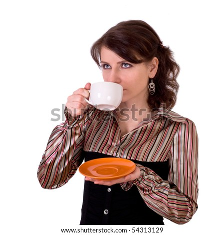 The nice girl drinks tea from a white cup - stock photo