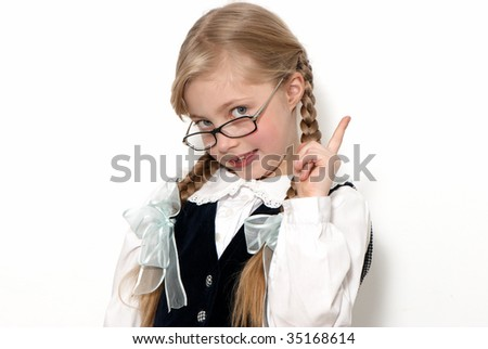 The nice schoolgirl in glasses on a light background. Gestures - stock photo
