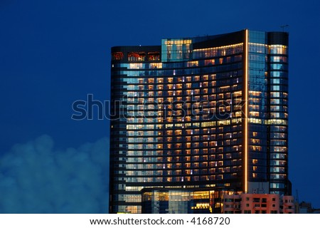 The night scene of office building with lights - stock photo